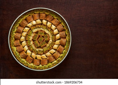 Traditional turkish, arabic sweets baklava assortment with pistachio. Top view, copy space                                    - Shutterstock ID 1869206734