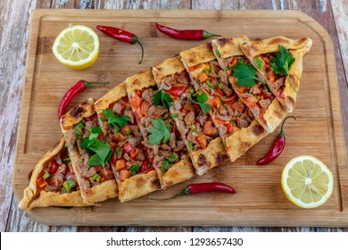 Traditional turkish baked dish pide. Turkish pizza pide, Middle eastern appetizers. Turkish cuisine. Top view. Pide with meat filling.