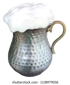 Traditional Turkish beverage Ayran made with yoghurt and water in metal vintage old glass cup on isolated white background.
