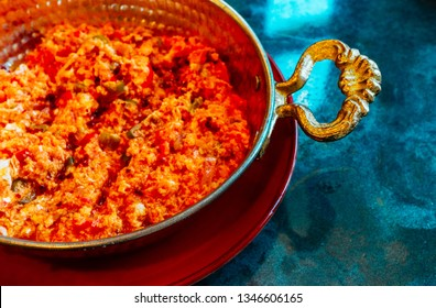 Traditional Turkish breakfast eggs scramble. Menemen omelet with spices and vegetables, oriental metal plate.