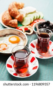 Traditional Turkish breakfast with fried eggs and tea. Travel concept