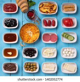 Traditional Turkish breakfast with special menemen on turquoise wooden background