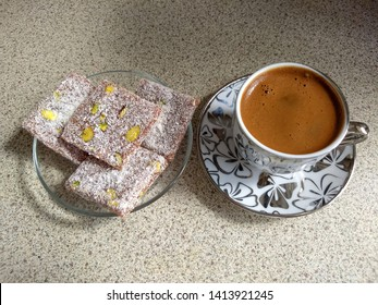 traditional turkish coffee is served with cezerye, cezerye is made with boiled carrots, sugar, pistachio and coconut, it is located dessert of adana and mersin, adana and mersin are cities in turkey