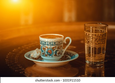 traditional turkish coffee served with porcelain chinaware cup, turkish delight and glass of water