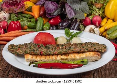 Traditional Turkish cuisine. Adana style Beyti kebab with garlic.