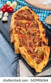 Traditional Turkish Cuisine; pide with cubed meat / kusbasili pide.Turkish pita concept.