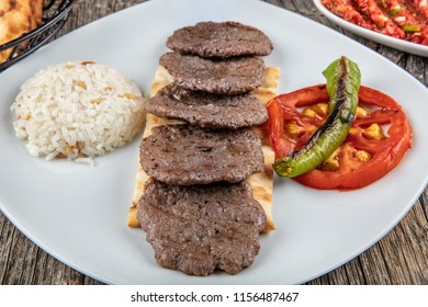 Traditional Turkish cuisine, sivas leaf meatball, rice, ayran. On the wooden floor.