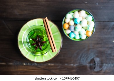 Traditional turkish delight leblebi and mint tea on rustic background with copy space