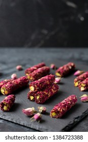 Traditional Turkish delights lokum on a dark slate board. Copy space