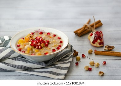 Traditional Turkish dessert Asure or Ashure from the boiled cereals with dried fruits and pomegranate grains.