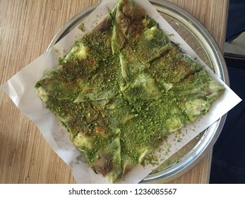 Traditional Turkish Dessert Katmer, clotted cream, dough, katmer dessert of Turkey Gaziantep region. Prepared with thin dough dessert with ice cream and green pistachio.