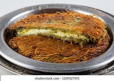 Traditional Turkish Dessert Kunefe/ Kunefe. The Turkish name is '' Harbiye Kunefe ''.