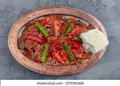 Traditional Turkish Doner Kebab also known iskender. Turkish style doner kebab food on wooden table background.