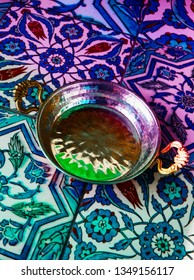 Traditional Turkish empty food plate for Menemen omelet, tile with oriental floral ornament on the background.
