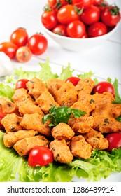 Traditional Turkish Food with Bulgur and Lentil. Mercimek Koftesi. Lentil Patties served with lettuce and tomates.