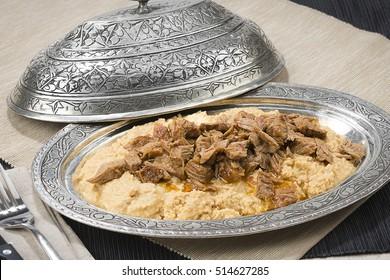 Traditional Turkish food called Hunkar Begendi, lamb stew served on mashed eggplant.