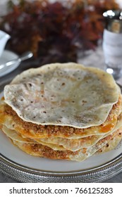 Traditional Turkish food ;Layers of Flat Breads with Ground Meat and Vegetable Topping which called Yaglama in Kayseri/Turkey