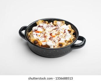 Traditional Turkish food. Manti, Turkey kolay yufka manti oven backed with tomato sauce