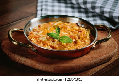 Traditional turkish food menemen made by eggs and tomatoes.