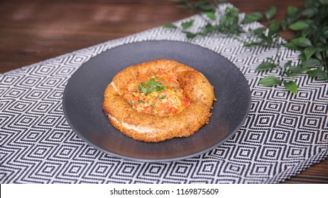 Traditional turkish food menemen made by eggs and tomatoes with sesame bagel