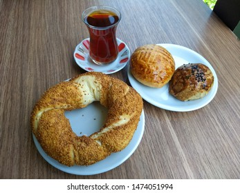traditional turkish food simit for breakfast, simit is salty pastry with sesame seeds, turkish black tea with turkish pastry