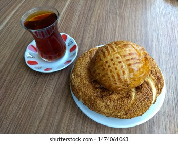 traditional turkish food simit with plain pastry and turkish black tea for breakfast, simit is salty pastry with sesame seeds