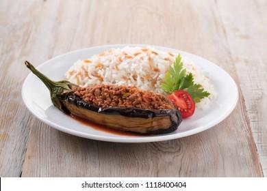 Traditional Turkish food stuffed aubergine ( karnıyarık ) on a wooden background