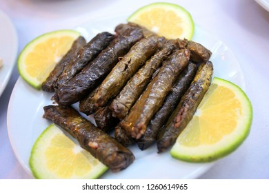 Traditional Turkish food 'Stuffed Grape Leaves' (Yaprak Sarma) in the restaurant table in Antakya, Turkey.