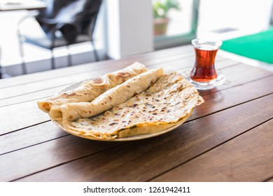 Traditional Turkish foods borek and sikma. Borek and sikma yufka on the table. Traditional Turkish food culture or cuisine.