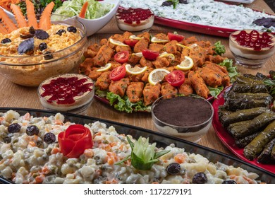 Traditional Turkish Foods Served in Big Trays at Restaurant for Sale. ( raw meatballs, leaf wrapping, yogurt quince, sweet, salad, rus salad, carrot tarator )