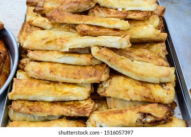 Traditional Turkish fried feta rolls called Sigara Boregi or borek, made of cheese, ready to eat and available for sale at a street food market