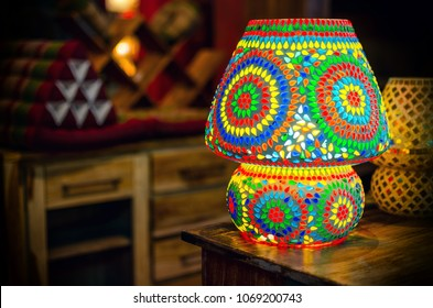 Traditional turkish glass table lamp on a wooden desk