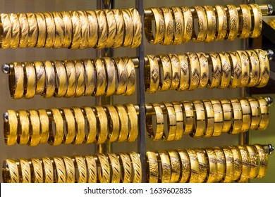 Traditional turkish gold oriental bracelets for women orient background.