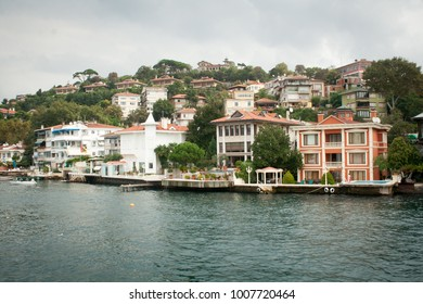 Traditional Turkish houses on the shores of Bosporus strait, in Istanbul, Turkey, seen from water cruise