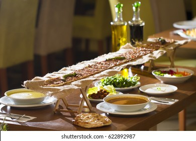 Traditional Turkish Iftar Table with soup, salad, yogurt, pide, kebab.
