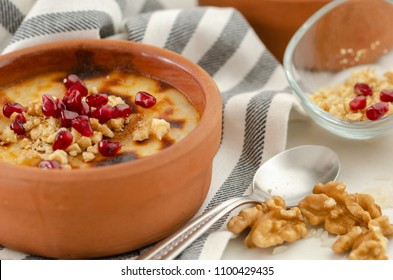 Traditional Turkish oven rice pudding..There are walnuts and pomegranate on the rice puding.Close-up