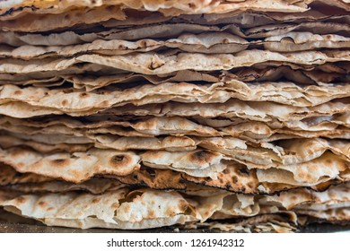 Traditional turkish pide or pita bread. Also known as yufka ekmek. Traditional turkish yufka ekmek, tandir pita ekmek background. Traditional Turkish food cuisine culture. Turkish village Breakfast.