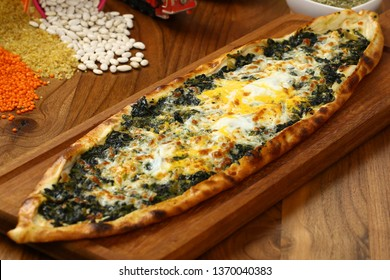 Traditional turkish pide with spinach, cheese and egg - Turkish pizza with spinach