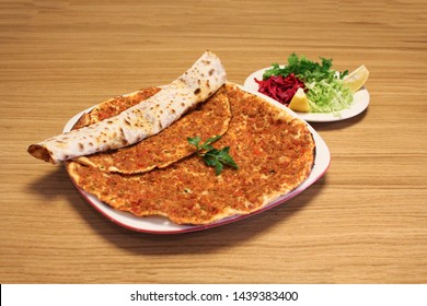 Traditional turkish pizza, lahmacun Turkish cuisine and salad
