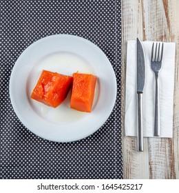 Traditional Turkish pumpkin dessert. Pieces of sweet baked pumpkin. The Turkish dish - Kabak Tatlisi
