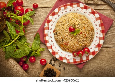 Traditional Turkish Ramadan iftar food Bulgur pilavi pilaff with tomatoes and rice concept background