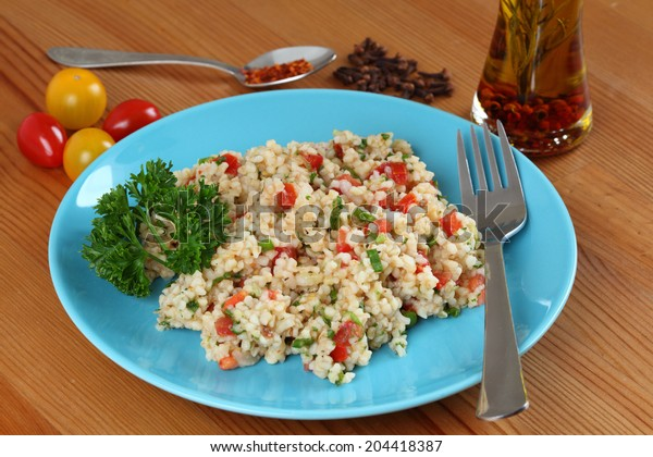 Traditional turkish salad with bulgur, tomatoes and parsley