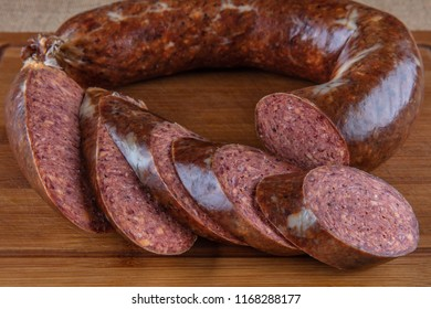 Traditional Turkish sausage , Sucuk on the wooden table.
