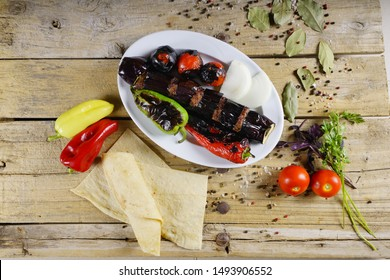 traditional turkish shish kebap with aubergine and pepper and tomatoes