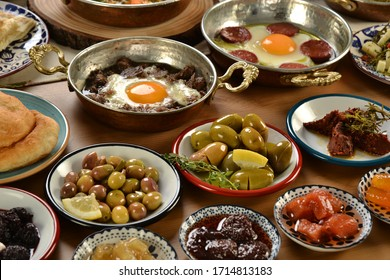 traditional turkish spreading breakfast. colorful plates. with hot food and copper pan presentations.
