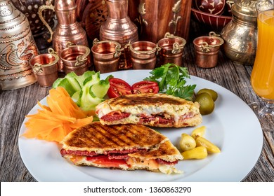 Traditional Turkish toast flat baked bread called bazlama on wooden table - Bazlama Tost.