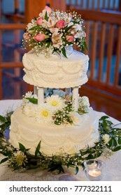 Traditional Two Tiered White Wedding Cake with Pink and White Flowers