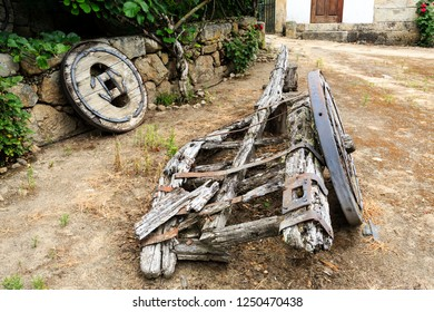 Traditional two-wheeler ox cart (or bullock cart) entirely made of timber in advanced state of disrepair, in Northern Portugal