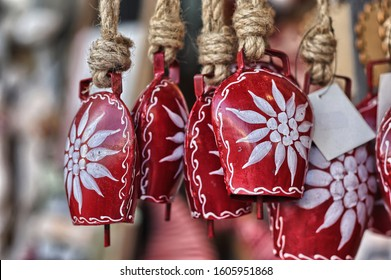 Traditional Tyrolean red cowbells with a drawn edelweiss