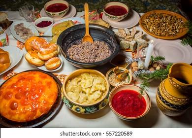 Traditional Ukrainian food.Kutya, borsch, dumplings, cabbage rolls on festive table.